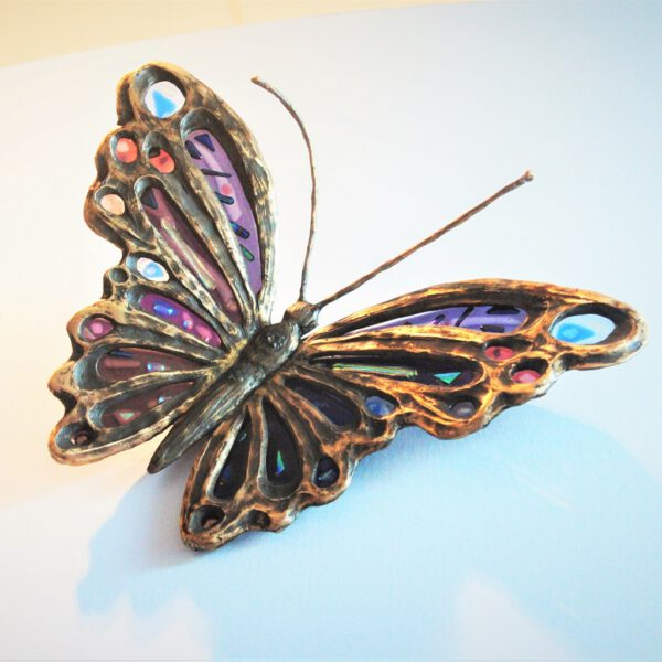 vlinder in brons en glas